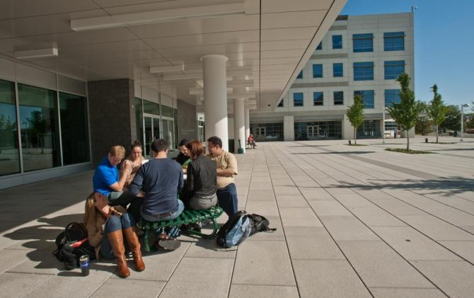 Students study outside Founders Hall at Arlington Campus. Photo by Creative Services/George Mason University